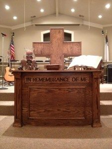 big wooden cross and pulpit