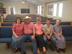 family on church pew