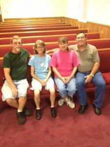 people sitting on church pew
