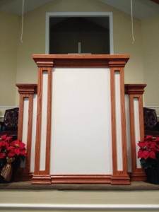 Wooden church pulpit painted white