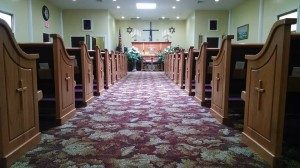 church pews with crosses