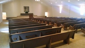 Church pews with book racks