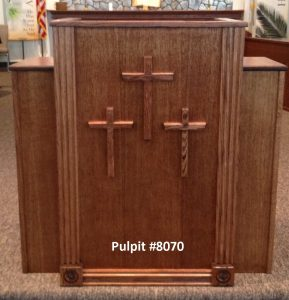 wooden pulpit with three crosses