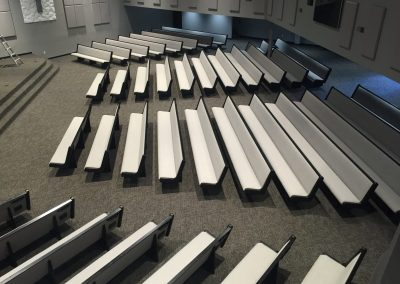 rows of white church pews