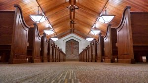 rows of wooden church pews