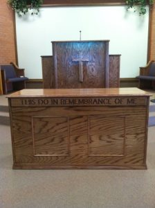 wooden closed table and pulpit with cross
