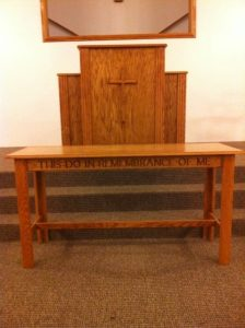 church table and pulpit with cross