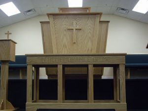 pulpit with cross and church table