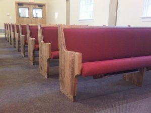 looking down a row of church pews