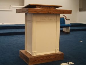 white and wooden pulpit