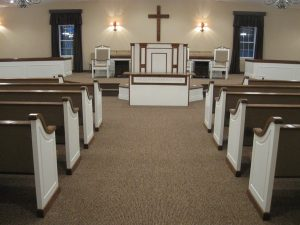 pews and pulpit as seen from aisle