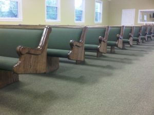 row of church pew ends
