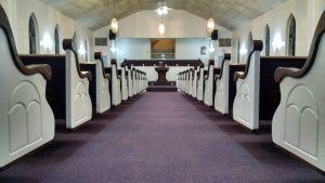 looking down church aisle