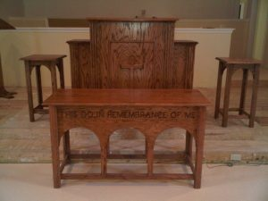 wooden arched table and pulpit with cross
