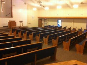 rows of church pews back view