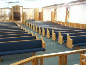 rows of pews with blue fabric
