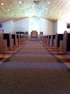 church pews as seen from aisle