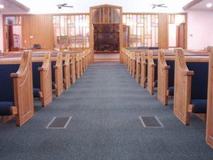 blue cushioned church pews