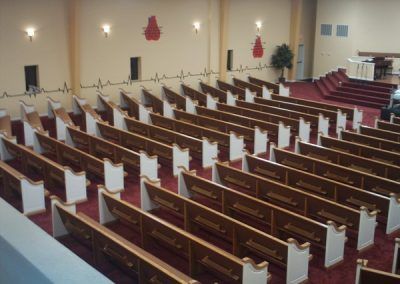 high view of rows of pews