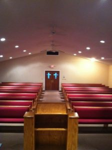inside of church with red pews