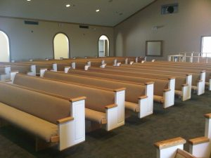 white golden oak church pews