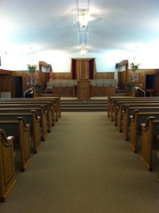 church aisle, pews, and pulpit