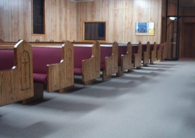 rows of church pews with crosses