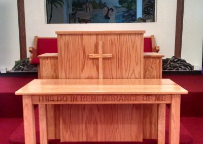 wooden pulpit with cross and church table