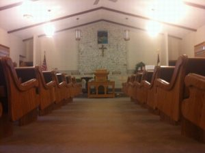church pews view from aisle
