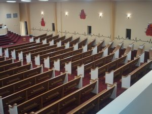 high view of rows of church pews