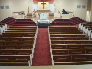 high view of the back of rows of pews