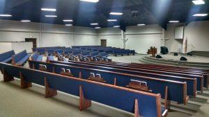 rows of blue church pews Needmore PA