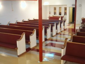 white and red church pews