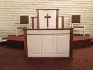 white pulpit with cross