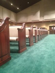 looking down a row of pews