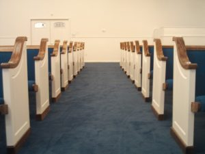 white church pews with blue cushions