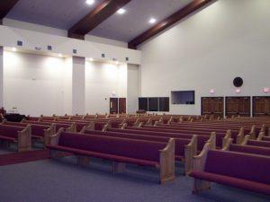 red cushioned church pews