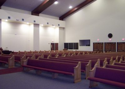 red cushioned church pews