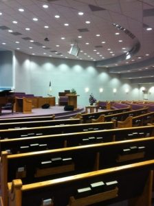 rows of church pews with bible holders
