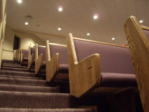 end of pews with cross