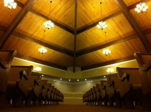 rows of church pews from aisle