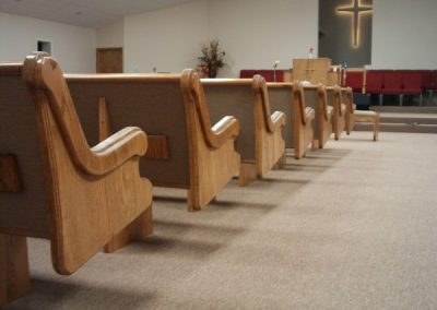 ends of church pews from behind
