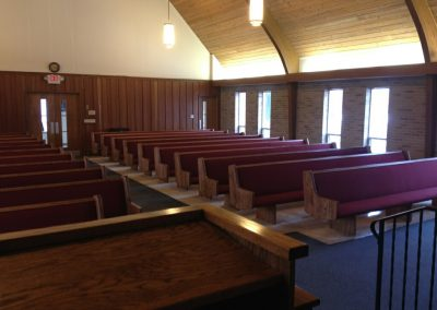 front  view of red church pews