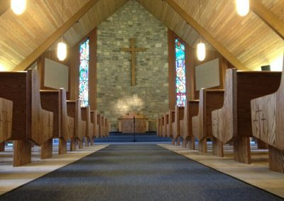 church aisle with wooden pews