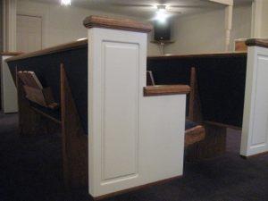 white church pew end