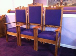 purple church chairs with curved tops