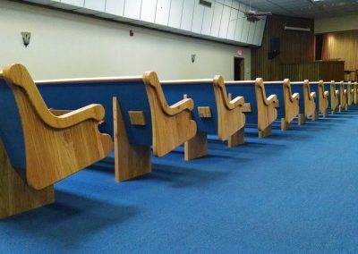 ends of blue church pews