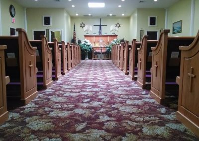 church aisle and pews with cross