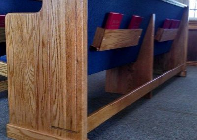 back of church pew and bible holder