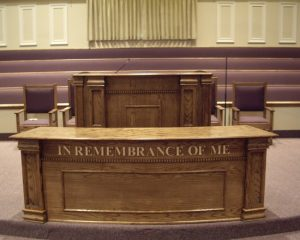 """wooden pulpit and """"in remembrance of me"""" table"""